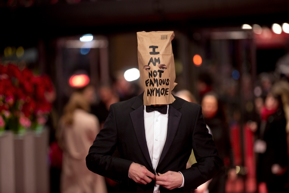 Actor Shia LaBeouf poses for photographers, with a paper bag over his head that says 'I am not famous anymore' on the red carpet for the film Nymphomaniac at the International Film Festival Berlinale in Berlin, Sunday, Feb. 9, 2014. (AP / Axel Schmidt)