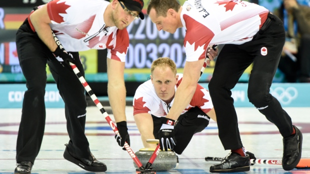 Canada's skip Brad Jacobs delivers a shot in Sochi