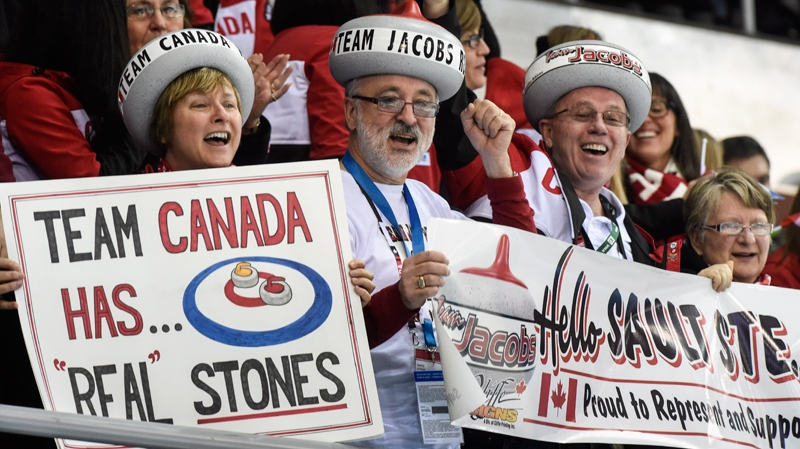 Fans cheer on the Canadian curling team during first round curling at the Sochi Winter Olympics Monday, February 10, 2014 in Sochi. (THE CANADIAN PRESS/Paul Chiasson)