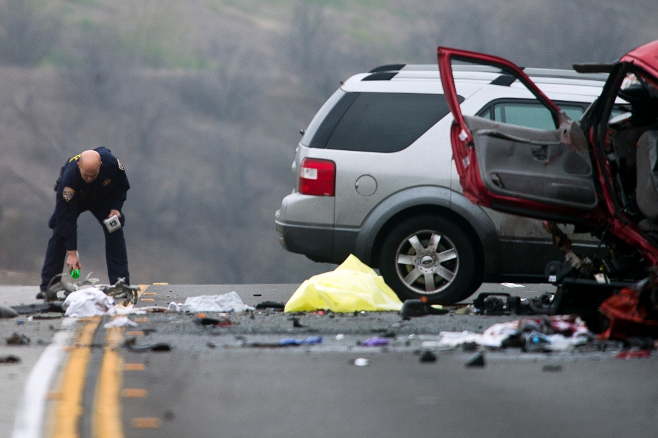 Officials investigate the scene of a multiple vehicle accident where 6 people were killed on the westbound Pomona Freeway in Diamond Bar, Calif. on Sunday morning, Feb. 9, 2013. (AP / San Gabriel Valley Tribune,Watchara Phomicinda)
