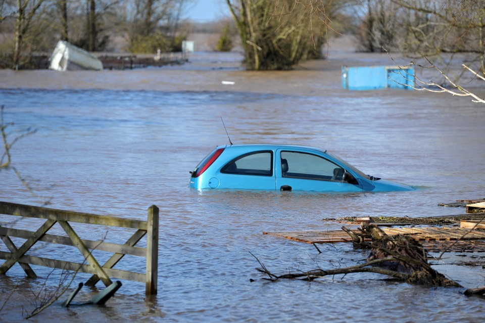 A car stands in the floodwater at Burrowbridge, southwestern England Sunday Feb. 9, 2014. (AP / Tim Ireland/PA)