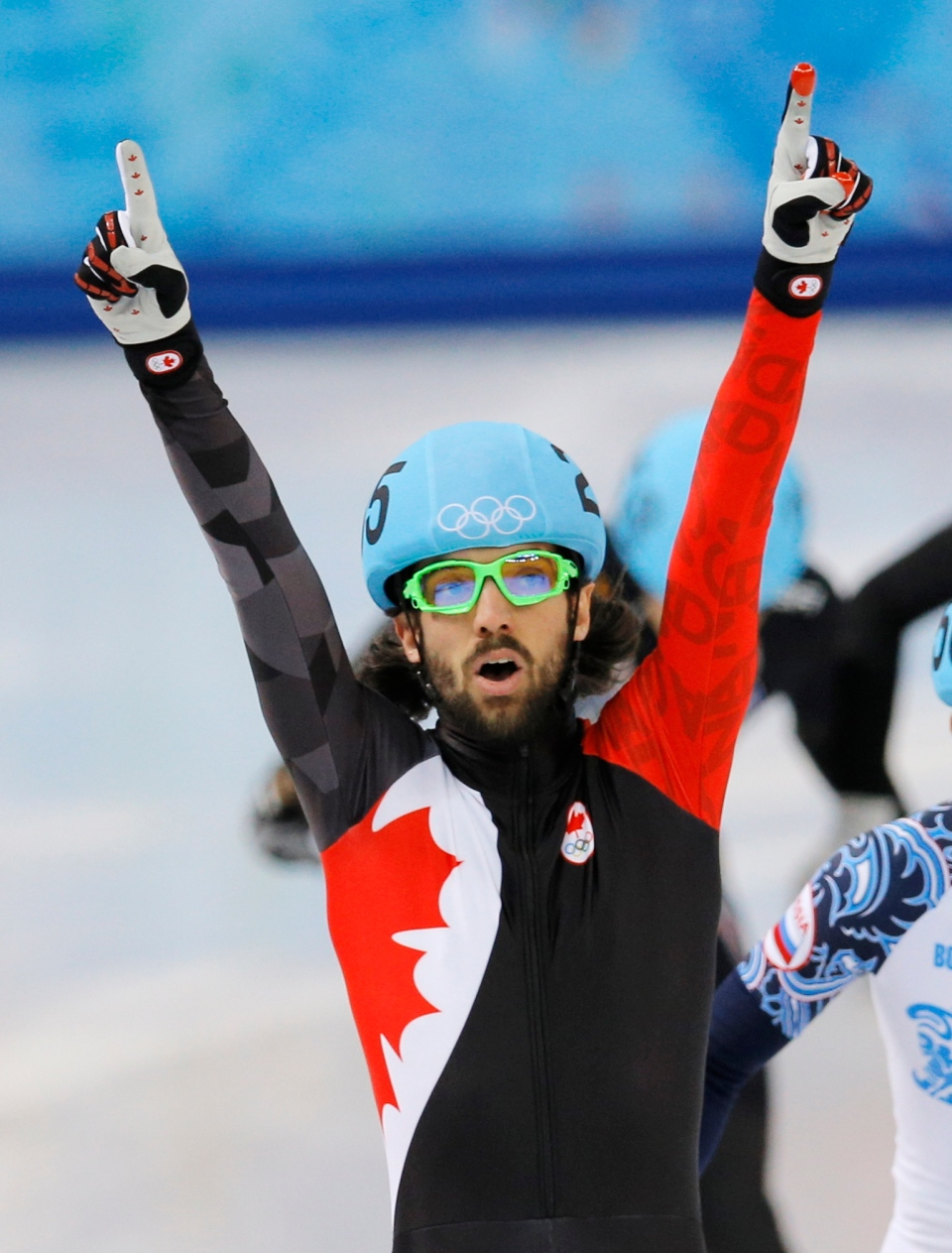 Charles Hamelin of Canada celebrates after winning the men's 1500m short track speedskating final at the Iceberg Skating Palace during the 2014 Winter Olympics, Monday, Feb. 10, 2014, in Sochi, Russia. (AP Photo/Vadim Ghirda)