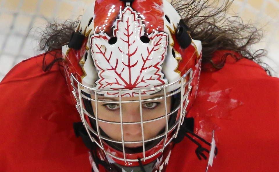 Goalkeeper Shannon Szabados of Canada looks out from her mask as she waits for the game against Finland to begin before the 2014 Winter Olympics women's ice hockey match at Shayba Arena  in Sochi, Russia, Monday, Feb. 10, 2014. (AP / J. David Ake)