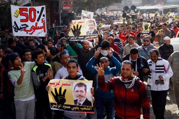Morsi says protests are 'useless'