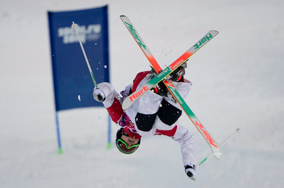 Canada's Alex Bilodeau jumps during freestyle skiing moguls training at the Rosa Khutor Extreme Park ahead of the 2014 Winter Olympics, Friday, Feb. 7, 2014, in Krasnaya Polyana, Russia. (AP / Andy Wong)