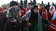 Two women are evacuated from Homs, Syria