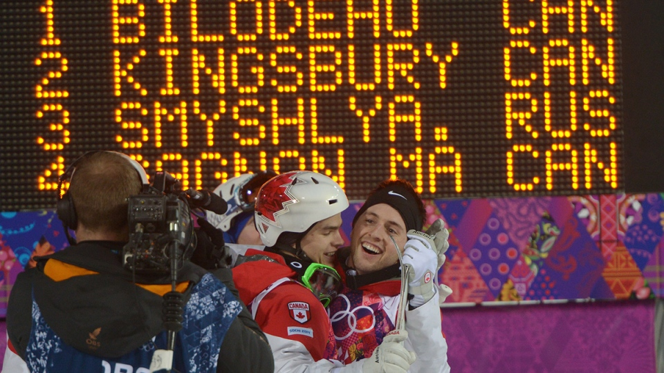 Canada's Alex Bilodeau, right, and Mikael Kingsbury celebrate after the third finals run in the men's moguls freestyle skiing event at the Sochi Winter Olympics in Krasnaya Polyana, Russia, Monday, Feb. 10, 2014. (Jonathan Hayward / THE CANADIAN PRESS)
