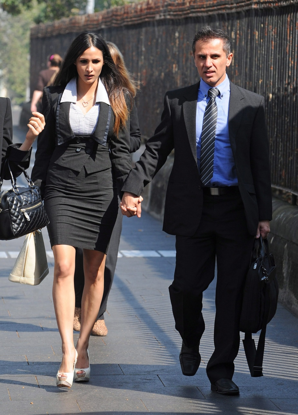 Australian Simon Gittany arrives at the Supreme Court in Sydney, Australia with his current girlfriend Rachelle Louise, Sydney, in this Friday, Nov. 8, 2013 photo. (AAP / Dan Himbrechts)