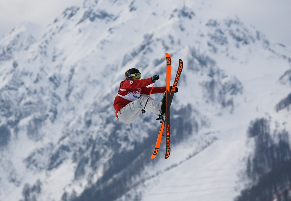 Canada's Dara Howell takes a jump during the women's freestyle skiing slopestyle qualifying at the Rosa Khutor Extreme Park, at the 2014 Winter Olympics, Tuesday, Feb. 11, 2014, in Krasnaya Polyana, Russia.(AP / Sergei Grits)