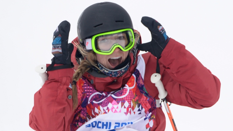 Canada's Dara Howell celebrates her score in the first run of the Ladies Ski Slopestyle final at the Sochi Winter Olympics in Krasnaya Polyana, Russia, Tuesday, Feb. 11, 2014. (Jonathan Hayward / THE CANADIAN PRESS)