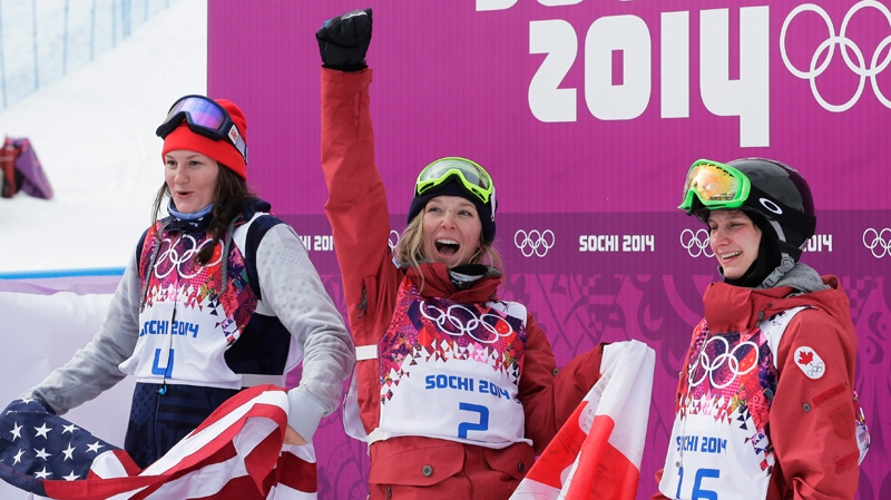 Canada's Dara Howell, centre, celebrates after taking the gold medal in the women's freestyle skiing slopestyle final at the Rosa Khutor Extreme Park at the 2014 Winter Olympics, Tuesday, Feb. 11, 2014, in Krasnaya Polyana, Russia. With her are silver medalist Devin Logan of the United States, left, and bronze medalist Kim Lamarre of Canada. (AP / Andy Wong)