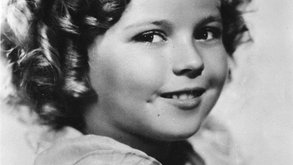 Shirley Temple, the curly-haired child star who put smiles on the faces of Depression-era moviegoers, has died. She is pictured here in 1936 when she was 8-years-old. (AP Photo)