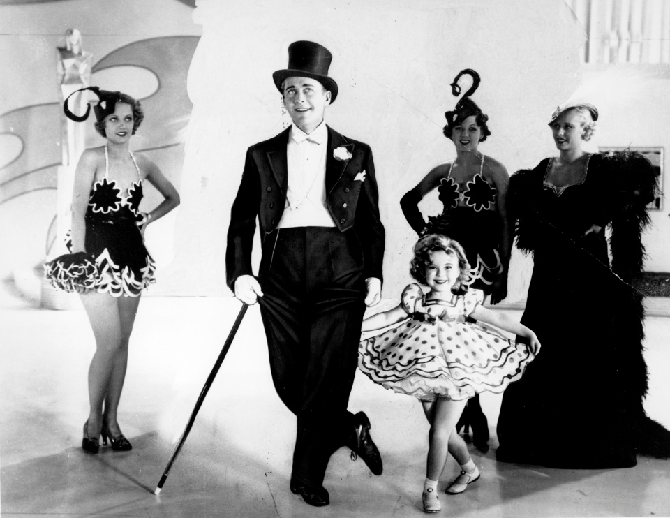 Shirley Temple as she appears in her first featured role in the 1934 musical 'Stand Up and Cheer' with James Dunn. (AP Photo)