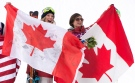 Gold medalist, Dara Howell, left, and bronze medalist, Kim Lamarre, both of Canada, celebrate their wins in the Ladies Ski Slopestyle final at the Sochi Winter Olympics in Krasnaya Polyana, Russia, Tuesday, Feb. 11, 2014. (Jonathan Hayward / THE CANADIAN PRESS)