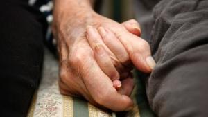 Jeannette Zeltzer, 81 and her boyfriend Max Rakov, 92, holding hands. (AP Photo/Greg M. Cooper)