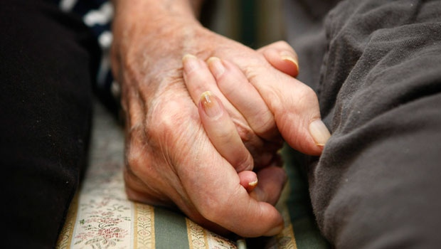 Jeannette Zeltzer, 81 and her boyfriend Max Rakov, 92, holding hands. (AP Photo/Greg M. Cooper)
