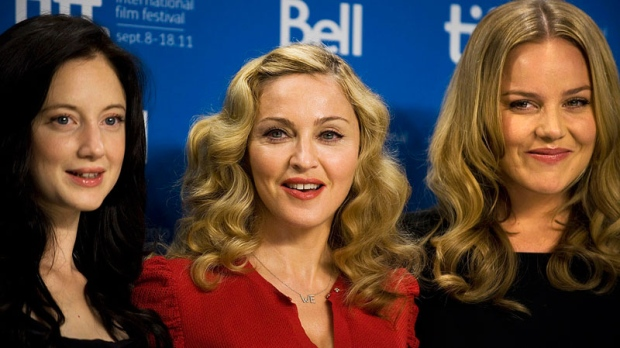 Andrea Riseborough, director Madonna, and Abbie Cornish, stand for a photo at a press conference promoting their new film 'W.E.' at the TIFF Lightbox during the Toronto International Film Festival in Toronto, on Monday Sept. 12, 2011. (Aaron Vincent Elkaim / THE CANADIAN PRESS)