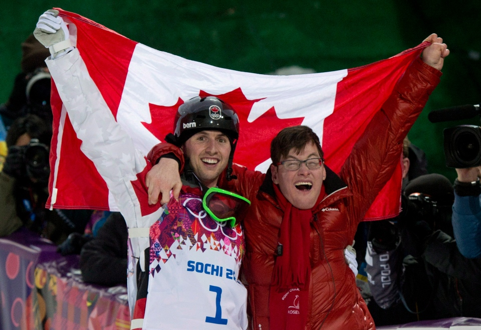 Canada's Alex Bilodeau, left, celebrates his win gold medal win with his brother Frederic following the moguls finals at the Sochi Winter Olympics in Krasnaya Polyana, Russia on Feb. 10, 2014. (Jonathan Hayward/THE CANADIAN PRESS)