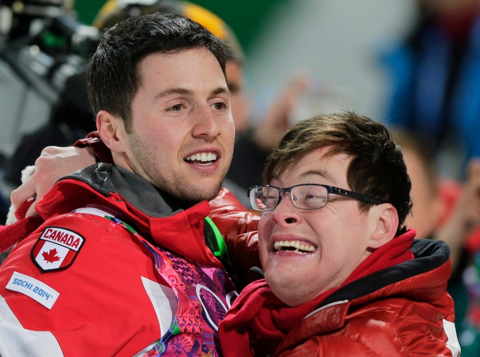 Canada's Alex Bilodeau, left, celebrates with his brother Frederic after winning the gold medal in the men's moguls final at the Rosa Khutor Extreme Park at the 2014 Winter Olympics on Feb. 10, 2014, in Krasnaya Polyana, Russia. (AP Photo/Andy Wong)