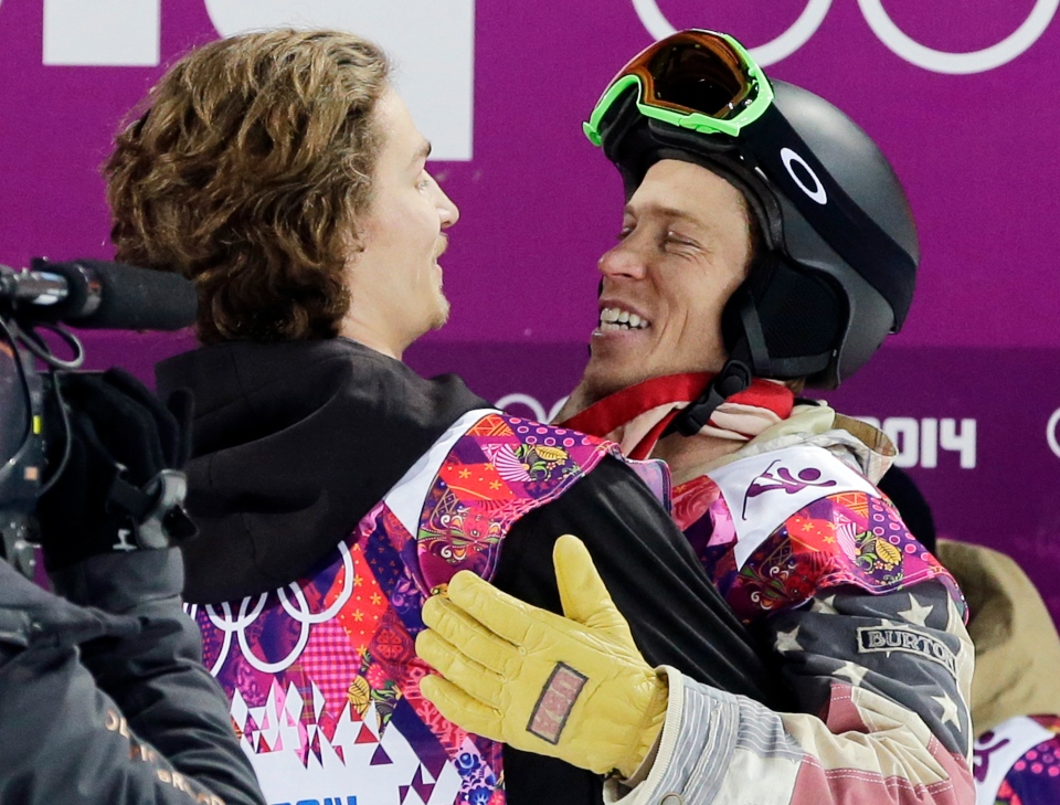 Switzerland's Iouri Podladtchikov, left, celebrates with Shaun White, of the United States, after Podladtchikov won the gold medal in the men's snowboard halfpipe final at the Rosa Khutor Extreme Park at the 2014 Winter Olympics on Feb. 11, 2014, in Krasnaya Polyana, Russia. (AP Photo/Andy Wong)