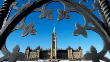 Centre Block shown through Parliament Hill gates