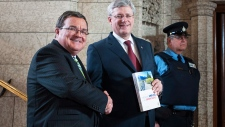 Flaherty and Harper hold the 2014 federal budget