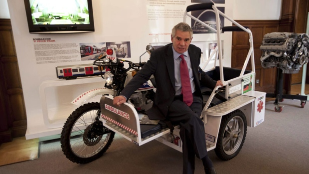 Designer Mike Norman poses for photographs on one of his eRanger motorcycle ambulances at the Institution of Mechanical Engineers in London