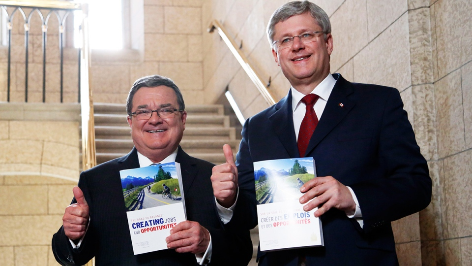 Minister of Finance Jim Flaherty and Prime Minister Stephen Harper enter the House of Commons on budget day on Parliament Hill in Ottawa on Tuesday, Feb. 11, 2014. (Patrick Doyle / THE CANADIAN PRESS)
