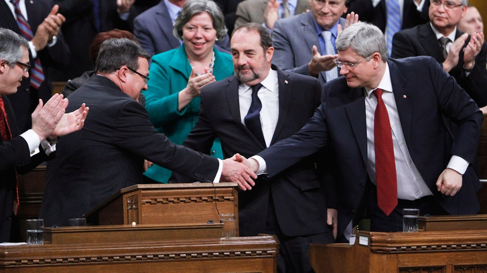 Prime Minister Stephen Harper (right) shakes hands with Finance Minister Jim Flaherty after he tabled the federal budget in the House of Commons on Parliament Hill in Ottawa on Tuesday, Feb. 11, 2014. (Fred Chartrand / THE CANADIAN PRESS)