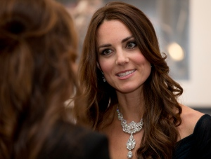 Kate Duchess of Cambridge talks to guests at a fund raising gala at the National Portrait Gallery in London, Tuesday, Feb. 11, 2014. The Duchess is wearing a dress by British designer Jenny Packham and a necklace on loan from Queen Elizabeth II that was given to the Queen as a gift for her wedding in 1947. (AP / Alastair Grant)