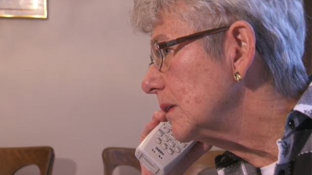 Barbara Davidson speaks with a representative from Citizens Bank after the balance was removed from a prepaid Visa card she had received for her birthday