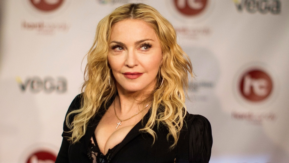 Madonna arrives at the opening of Toronto's Hard Candy Fitness on Tuesday Feb. 11, 2014. (Chris Young  / THE CANADIAN PRESS)