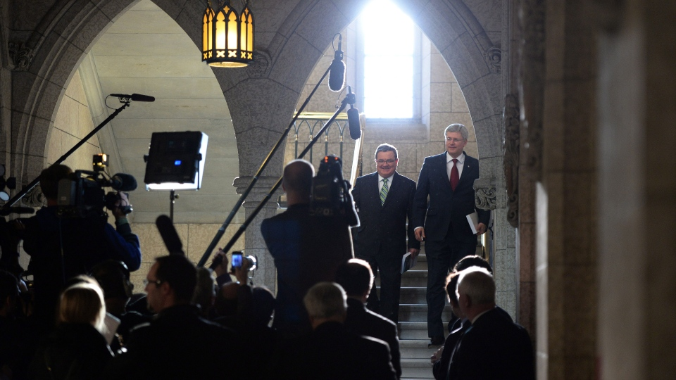 Minister of Finance Jim Flaherty and Prime Ministers Stephen Harper enter the House of Commons on budget day on Parliament Hill in Ottawa on Tuesday, Feb. 11, 2014. (Sean Kilpatrick / THE CANADIAN PRESS)