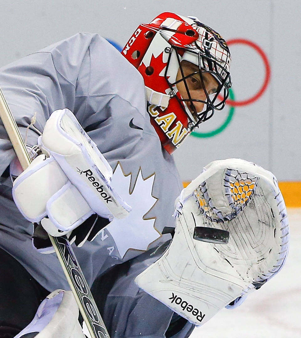 Canada goaltender Roberto Luongo blocks a shot during a training session at the 2014 Winter Olympics, Monday, Feb. 10, 2014, in Sochi, Russia. (AP / Julie Jacobson)