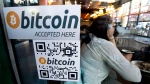 A Bitcoin ATM sticker is posted to the window of a coffee shop in Vancouver, Monday, Oct. 28, 2013. (Jonathan Hayward / THE CANADIAN PRESS)