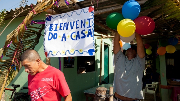 Relatives of Jose Salvador Alvarenga decorate home