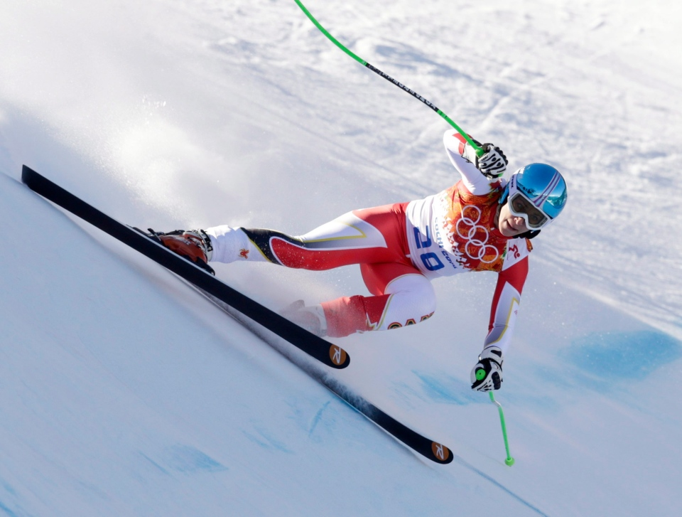 Canada's Larisa Yurkiw makes a turn during the women's downhill at the Sochi 2014 Winter Olympics in Krasnaya Polyana, Russia, Wednesday, Feb. 12, 2014. (AP / Charles Krupa)