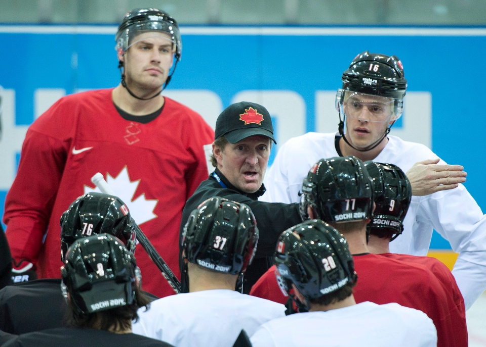 Canada's men's head coach Mike Babcock, centre, explains a drill to his players at hockey practice during the 2014 Sochi Winter Olympics in Sochi, Russia on Wednesday, Feb. 12, 2014. (Nathan Denette / THE CANADIAN PRESS)