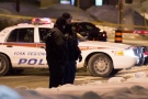 York Regional Police officers investigate a fatal stabbing near Davis Drive and Huron Heights Drive in Newmarket early Thursday, Feb. 13, 2014. (Tom Stefanac/CP24)