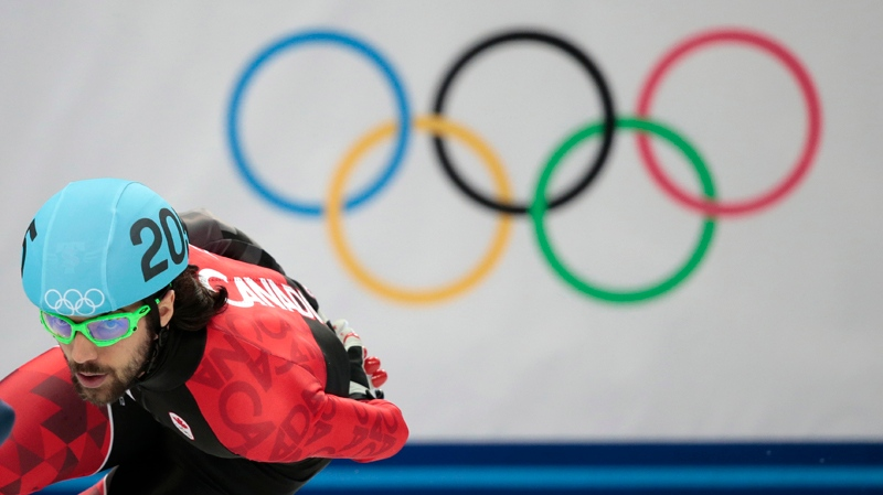 Charles Hamelin of Canada competes in a men's 1000m short track speedskating heat at the Iceberg Skating Palace during the 2014 Winter Olympics, Thursday, Feb. 13, 2014, in Sochi, Russia. (AP / Ivan Sekretarev)