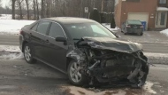 This unmarked police car rammed another car on Thursday morning, Feb. 13, 2014.