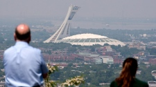Tourists check out Olympic Stadium in Montreal on May 31, 2010. (Paul Chiasson / THE CANADIAN PRESS)