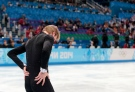 Evgeni Plushenko of Russia prepares to leave the ice after pulling out of the men's short program figure skating competition due to illness at the Iceberg Skating Palace during the 2014 Winter Olympics, Thursday, Feb. 13, 2014, in Sochi, Russia. (AP / Ivan Sekretarev)