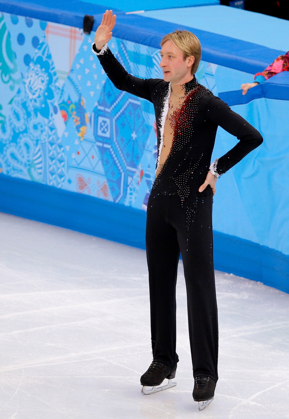 Evgeni Plushenko of Russia leaves the ice after pulling out of the men's short program figure skating competition due to illness at the Iceberg Skating Palace during the 2014 Winter Olympics, Thursday, Feb. 13, 2014, in Sochi, Russia. (AP Photo/Vadim Ghirda)