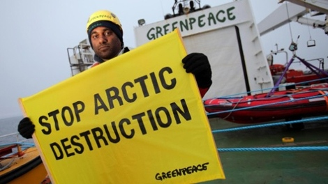 Greenpeace International Executive Director Kumi Naidoo prepares to take action on the Greenpeace ship Esperanza in the Davis Strait off the coast of Greenland. On Thursday, Naidoo will be on hand to celebrate Greenpeace's 40th birthday in Vancovuer. (Greenpeace) Sept. 14, 2011