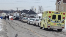An ambulance is parked near a home in Terrebonne