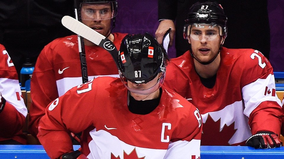 Canada captain Sidney Crosby has his face covered by his helmet after a hit against Norway during second period period preliminary action at the 2014 Sochi Winter Olympics in Sochi, Russia on Thursday, Feb. 13, 2014. (Nathan Denette / THE CANADIAN PRESS)