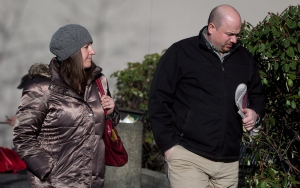 Robert MacKay, right, and an unidentified woman arrive at Provincial Court in Vancouver, B.C., on Tuesday February 4, 2014. (Darryl Dyck / THE CANADIAN PRESS)