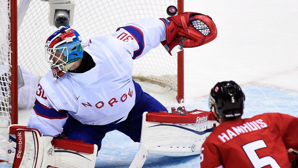 Canada defenceman Dan Hamhuis (5) watches the puck go past Norway goalie Lars Haugen during second period period preliminary action at the 2014 Sochi Winter Olympics in Sochi, Russia on Thursday, Feb.13, 2014. (Nathan Denette / THE CANADIAN PRESS)
