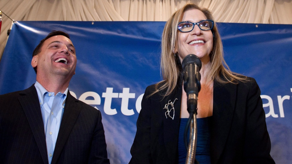 Ontario PC candidate for Thornhill Gila Martow celebrates a victory in the Thornhill byelection with Ontario PC leader Tim Hudak on Thursday February 13, 2014. (Galit Rodan / THE CANADIAN PRESS)